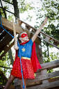 Superhero girl playing in a tree house - HMEF00566