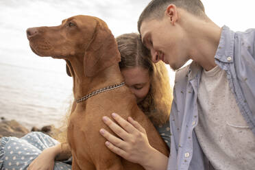 Young couple with dog at the beach - VPIF01507