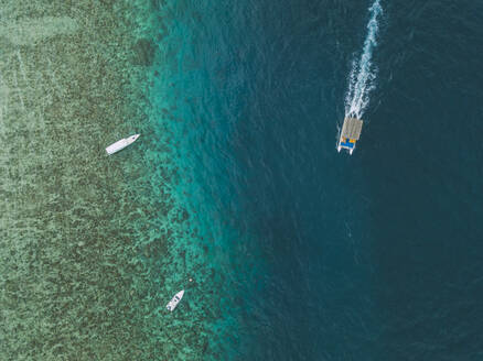 Aerial view of boats on sea at Gili-Air Island in Bali, Indonesia - KNTF03433