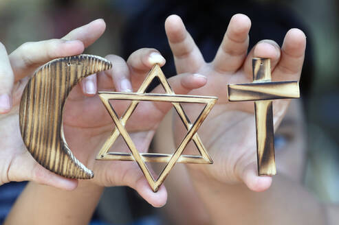 Christianity, Islam, Judaism, the three monotheistic religions with symbols of Jewish Star, Muslim Crescent and Christian Cross, Vietnam, Indochina, Southeast Asia, Asia - RHPLF11121
