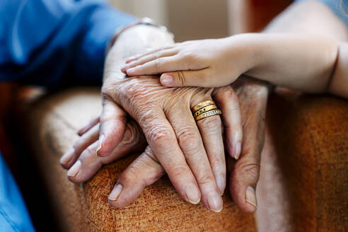 Elderly couple and baby's hand, generations together - GEMF03155