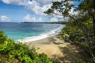 Scenic view of Turtle beach against cloudy sky at Tobago, Caribbean - RUNF03175