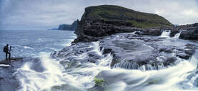 Panoramic of photographer at Bosdalafossur waterfall, Vagar island, Faroe Islands, Denmark, Europe - RHPLF11610