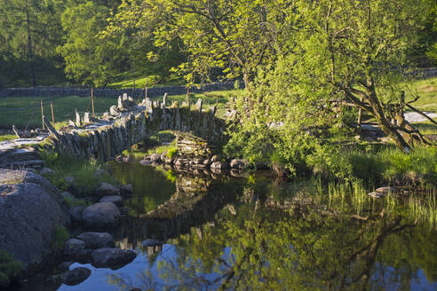 16th century Slater's Bridge reflected in the River Brathay, Little Langdale, Lake District National Park, UNESCO World Heritage Site, Cumbria, England, United Kingdom, Europe - RHPLF11939