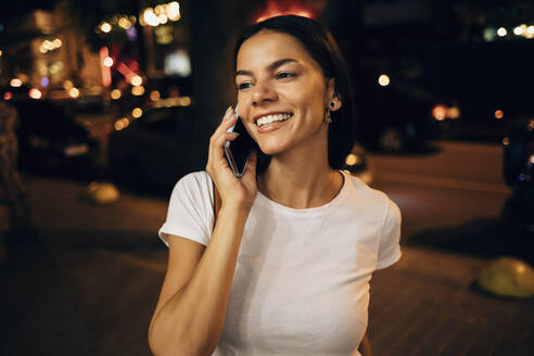 Young woman using smartphone in the city at night - OYF00067