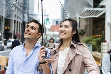 Happy couple with umbrella in Ginza, Tokyo, Japan - MCVF00020