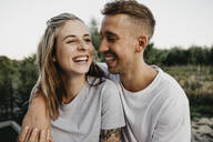 Portrait of young laughing couple - LHPF00874