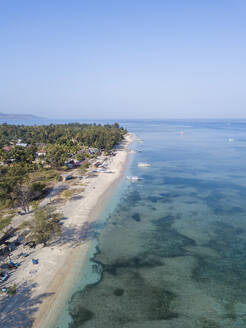 Aerial view of Gili islands against clear blue sky at Bali, Indonesia - KNTF03471