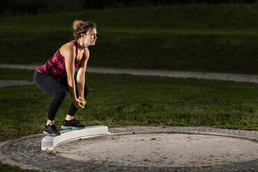 Femal shot-putter training with ball - STSF02259