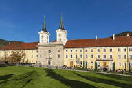 Tegernsee Abbey and St. Quirinus Church against clear blue sky in Bavaria, Germany - LHF00717
