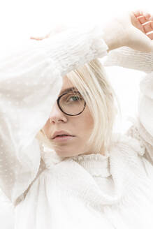 Portrait of blond young woman with glasses wearing white blouse - JESF00354