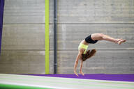Gymnast exercising on a mat - JSMF01296