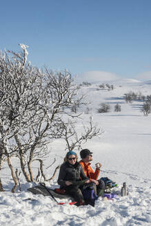 Couple of skiers relaxing - JOHF01476