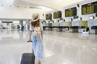 Young woman with baggage at the airport departure hall - IGG01336