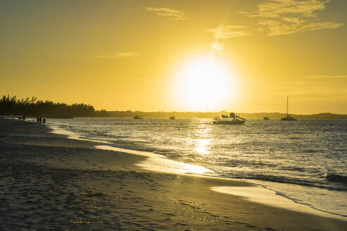 Scenic view of Grace Bay beach against sky during sunset, Providenciales, Turks And Caicos Islands - RUNF03350
