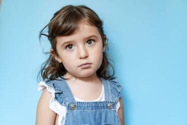 Portrait of sad girl, blue background - GEMF03183