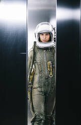 Man posing dressed as an astronaut in an elevator - DAMF00090