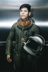 Man posing dressed as an astronaut in an elevator - DAMF00102
