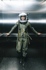 Man posing dressed as an astronaut in an elevator - DAMF00105