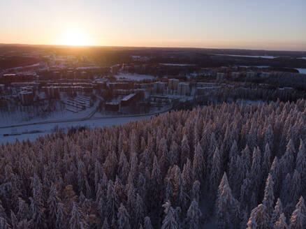 Finland, Kuopio, aerial view of winter landscape at sunset - PSIF00324