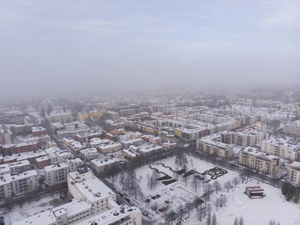 Finland, Kuopio, aerial view of city in snow - PSIF00327