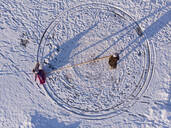 Finland, Kuopio, directly above view of mother and daughter playing in snow - PSIF00333