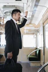 Young businessman on a train - JPIF00227