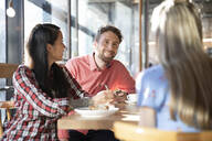 Friends meeting in a cafe - FKF03638