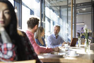 Casual business people having a meeting in a cafe - FKF03650