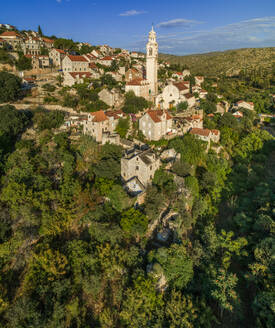 Aerial view of traditional dalmatian village of Lozisca, Brac Island, Croatia. - AAEF03722