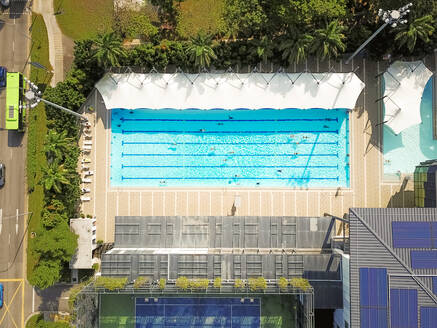 Aerial view of people swimming in an olympic pool in Singapore - AAEF03779