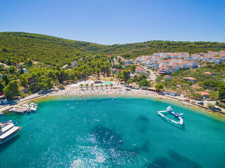 Aerial view of housing estate and beach at Necujam bay at Solta, Croatia - AAEF03953