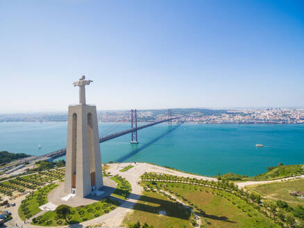 Aerial view of Sanctuary of Christ the King overlooking Lisbon and 25 de Abril Bridge connecting Lisbon and Almada - AAEF04184