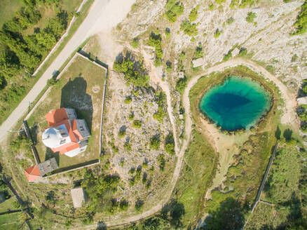 Aerial view of the Glavas source of the Cetina river and Orthodox Church, Croatia. - AAEF04253