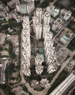 Aerial view of residential tower blocks in Hong Kong, China. - AAEF04472