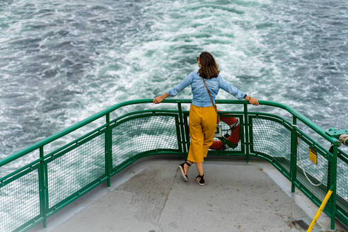 Stylish woman is enjoying the ride aboard Washington ferry in Seattle - CAVF63692