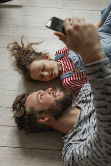 Father and daughter taking selfie - JOHF01993