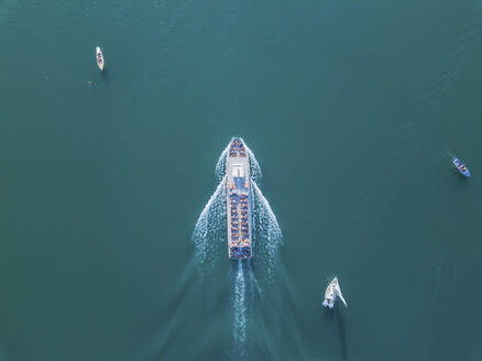 Germany, Bavaria, Aerial view of tourboat sailing between other boats across turquoise waters of Chiemsee lake - MMAF01158