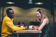 Couple having fun in a coffee shop - CJMF00051