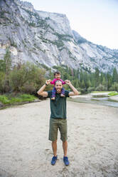 Portrait of happy father carrying little daughter on his shoulders, Yosemite National Park, California, USA - GEMF03205
