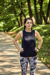Portrait of sporty young woman in forest - ZEDF02654