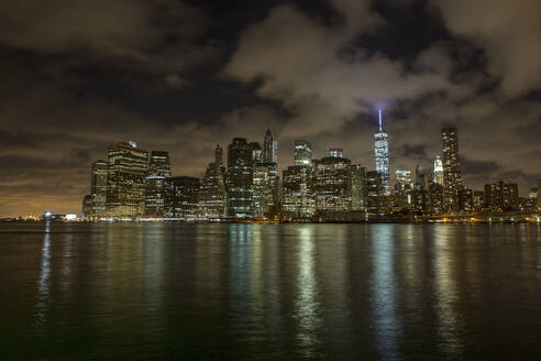 New York cityscape at night as seen from Brooklyn, New York. - CAVF64829