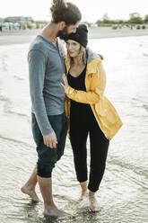 Couple walking at the beach in Heiligenhafen - NAF00156