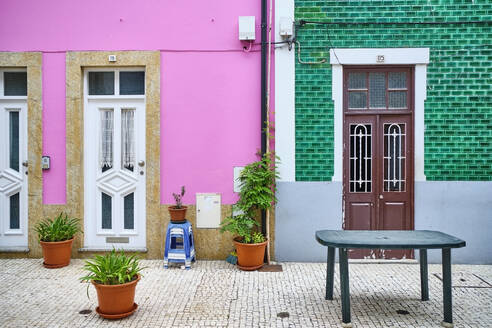 Portugal, Porto, Afurada, Front view of colorful houses on peaceful day - MRF02233