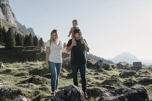 Happy family with little son on a hiking trip in the mountains, Schwaegalp, Nesslau, Switzerland - LHPF01070