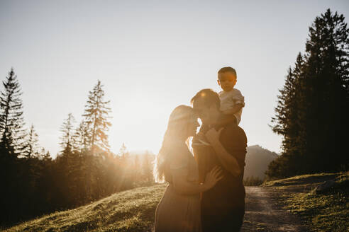 Affectionate family with little son on a hiking trip at sunset, Schwaegalp, Nesslau, Switzerland - LHPF01109