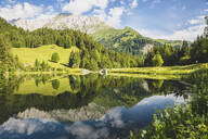 Austria, Carinthia, Scenic view of shiny lake in Carnic Alps - AIF00690