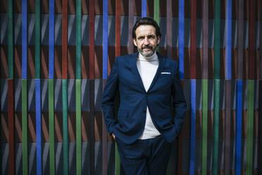Portrait of mature businessman wearing blue suit - JLOF00330