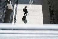 Top view of businessman with baggage on the go - DIGF08507