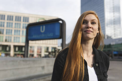Portrait of redheaded young woman at Alexanderplatz, Berlin, Germany - WPEF01995